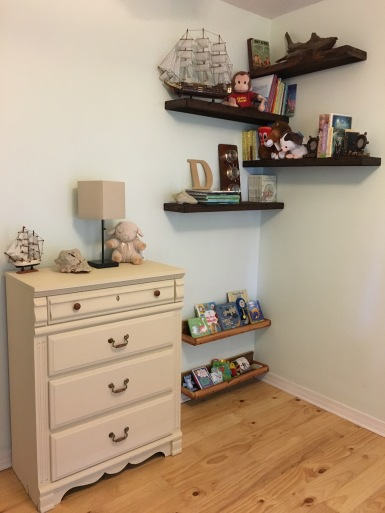 """We used floating shelves for the """"real"""" books & decorations. Gallery shelves hold soft & board books for Baby J to easily access. Instead of staining them, J rubbed them down with olive oil, giving them a finished look with no fumes. We also used chalk paint on the furniture to avoid any harmful chemicals in the air."""